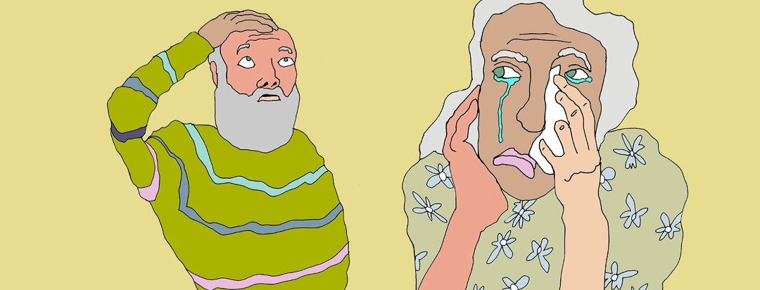 An older man scratches his head while an older woman in the foreground cries.