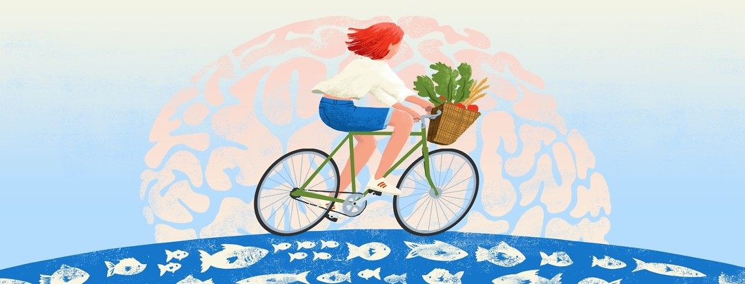 A woman rides a bike with a basket full of fresh veggies. The subtle shape of a brain is in the background/sky and the ground below her has on it a fish pattern.