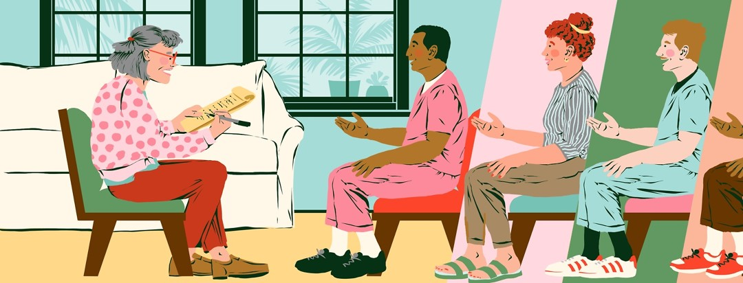 A woman sitting in her home with a legal pad interviews several different people for caregiver positions.