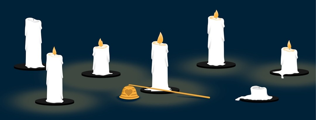 Candles of varying heights with a candle snuffer in front, some of the candles have been put out.