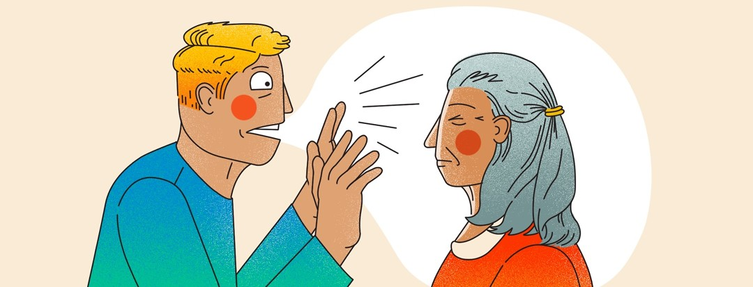 A younger adult man talks loudly and in the face of an older woman who has her eyes closed against the noise.