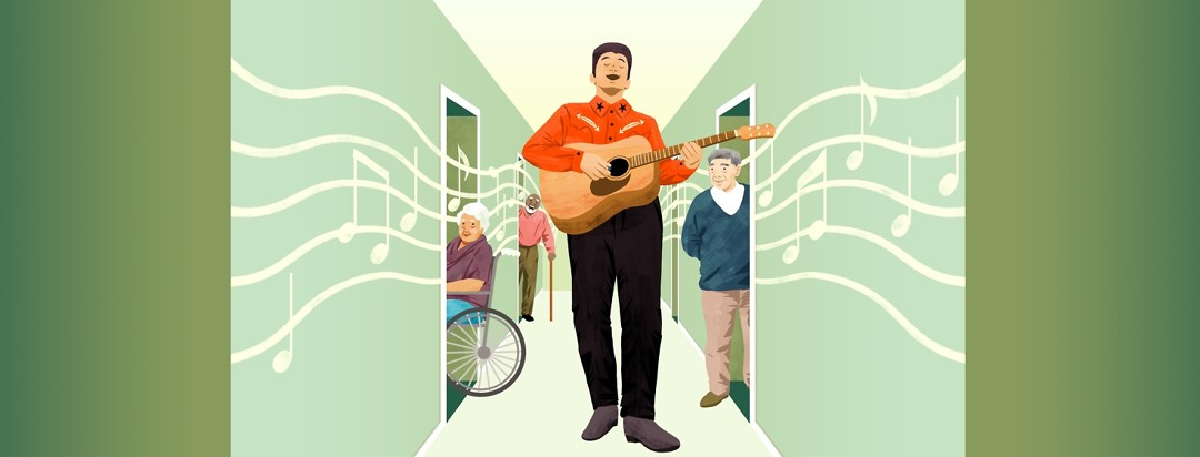 A man singing and playing guitar walks down the hallway of a nursing home and the residents excitedly poke their heads out of the doorways.