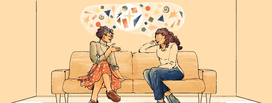 Two women sit on a couch talking. Speech bubbles of different colors contain various shapes.