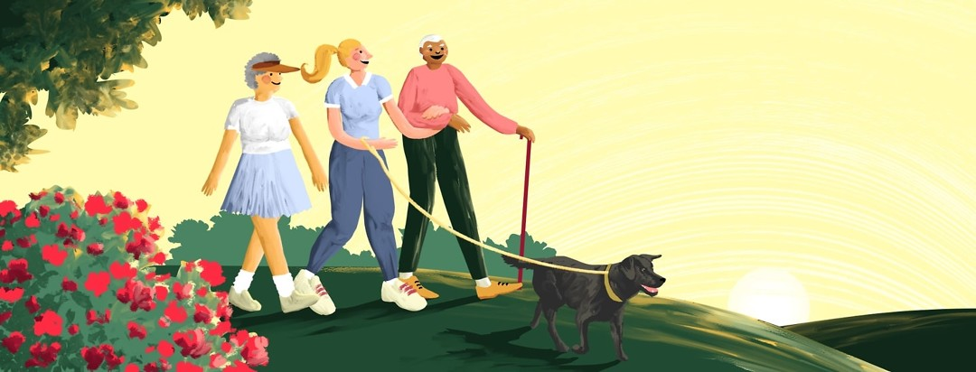 An older couple with their adult daughter are walking together through a pretty park at sunrise with their dog.