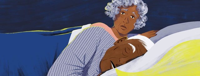 An elderly couple is in bed. The man is fast asleep and snoring and the woman is awake and looking concerned over his shoulder.