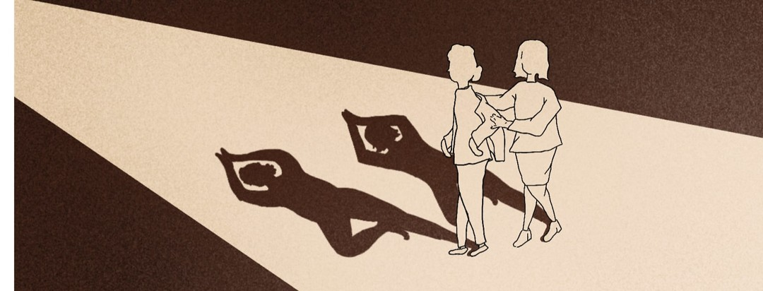 Person helping older woman put her jacket on with shadows of both of them in a yoga pose