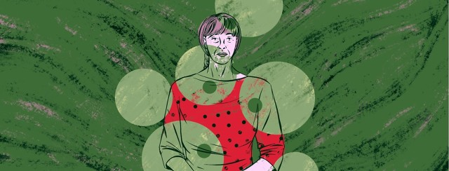 An older woman is partially covered by both large and smaller dots the same color as the background.