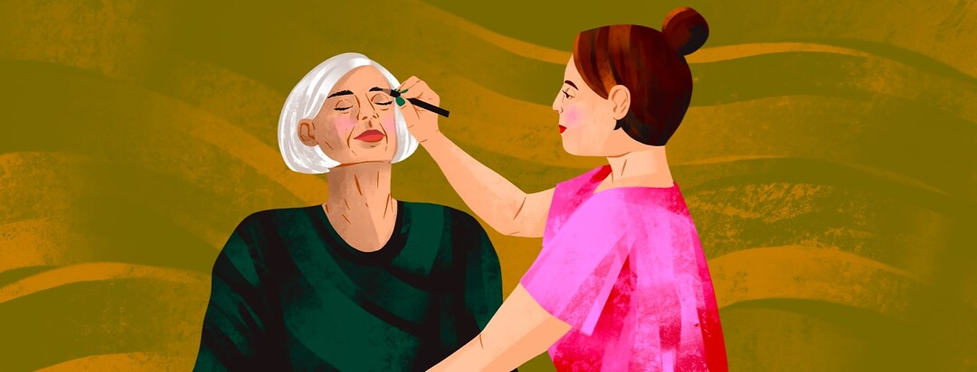 alt=A younger woman helps an older woman apply eyebrow pencil.