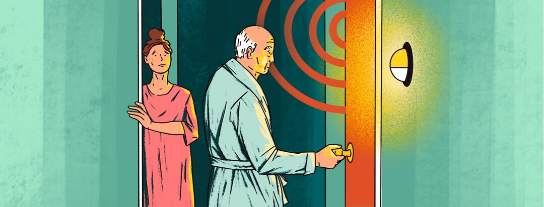 alt=An older man sets off a motion-sensor light and alarm when opening a door at night. A younger woman looks concerned.
