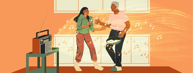 alt=a radio plays music while two people dance in the kitchen.
