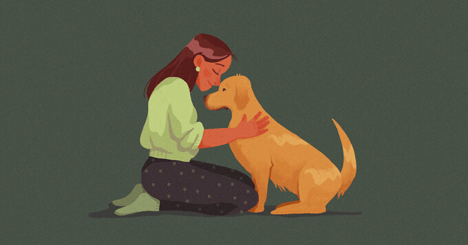 alt=A woman and a dog snuggle