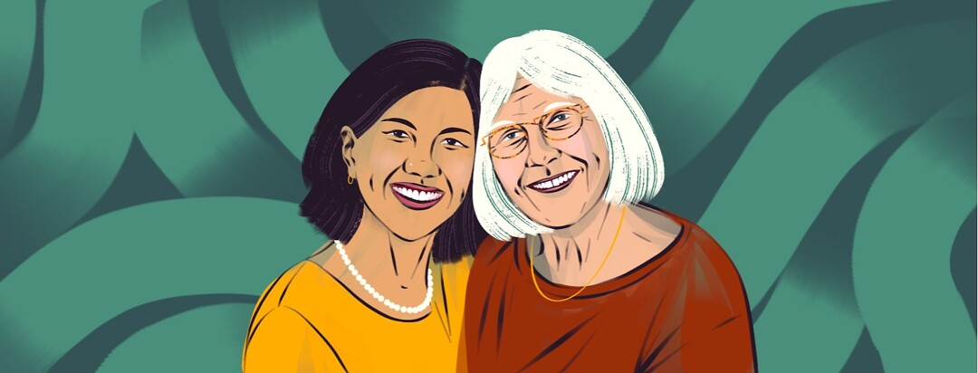 alt=a younger Asian woman and older white woman smile and lean on each other.