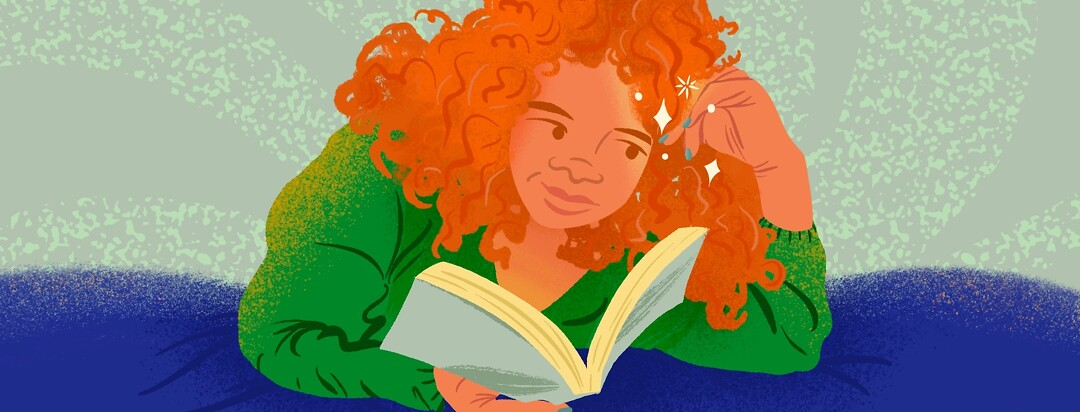 Woman with curly red hair reads book laying down, looking at her sparkling nails.