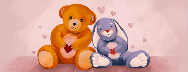 alt=a teddy bear and stuffed rabbit smile & hold hearts. Hearts float around them.